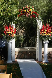 white wedding arch with flowers