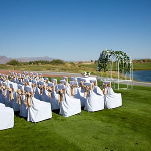 lawn wedding setup next to a pond